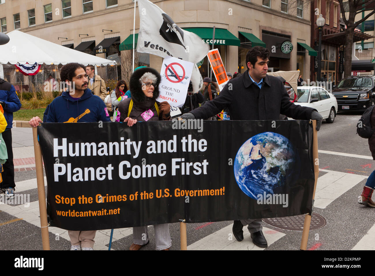 Environmental activists holding banner at protest rally - Washington, DC USA - Stock Image