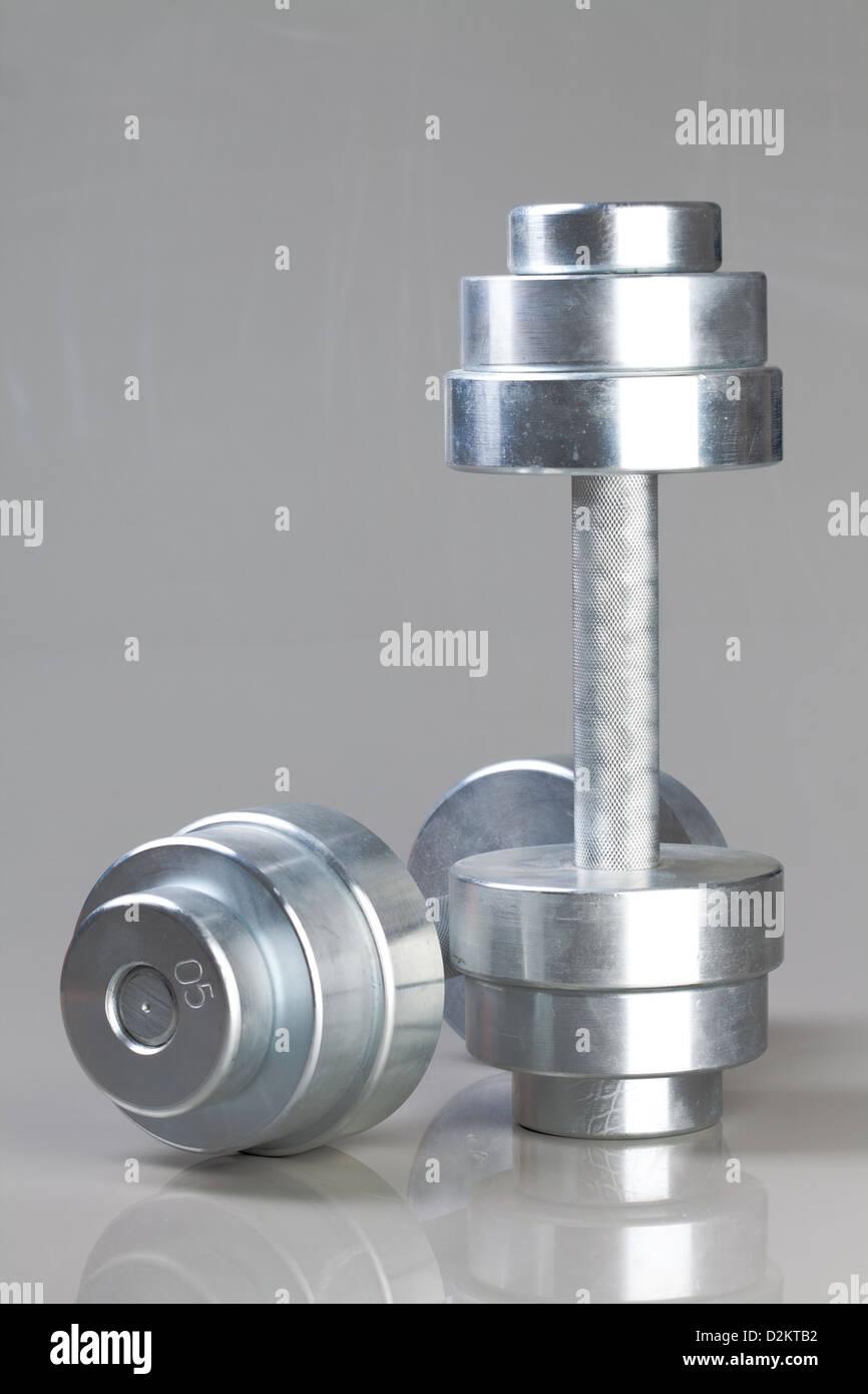 Photo dumbbells on a grey background - Stock Image