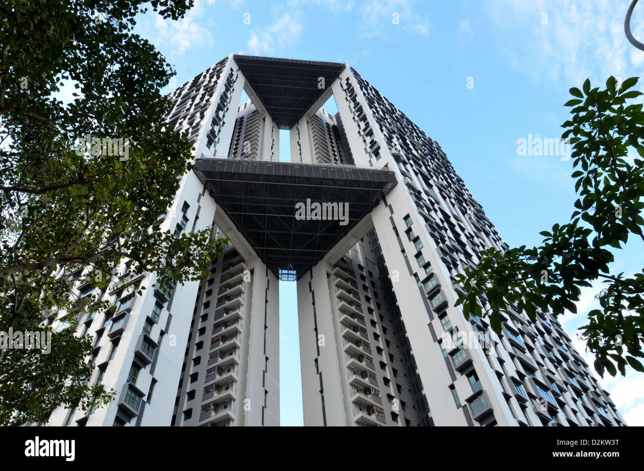 An imposing view of a modern high rise apartment building in Singapore. Note the protruding balconies at intermediate - Stock Image