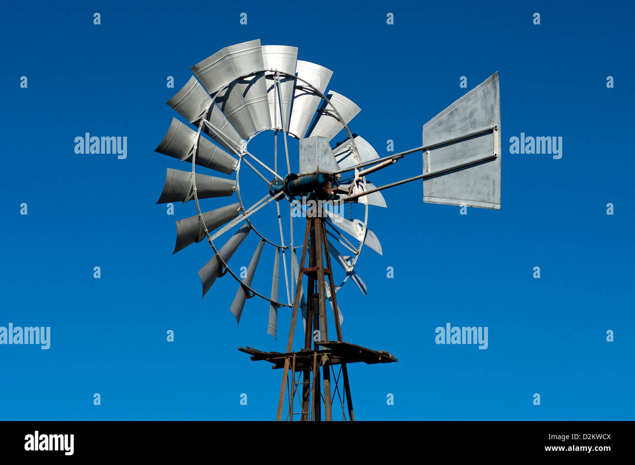Top of a multi-bladed wind pump with a weather vane for pumping groundwater, Namaqualand, South Africa - Stock Image