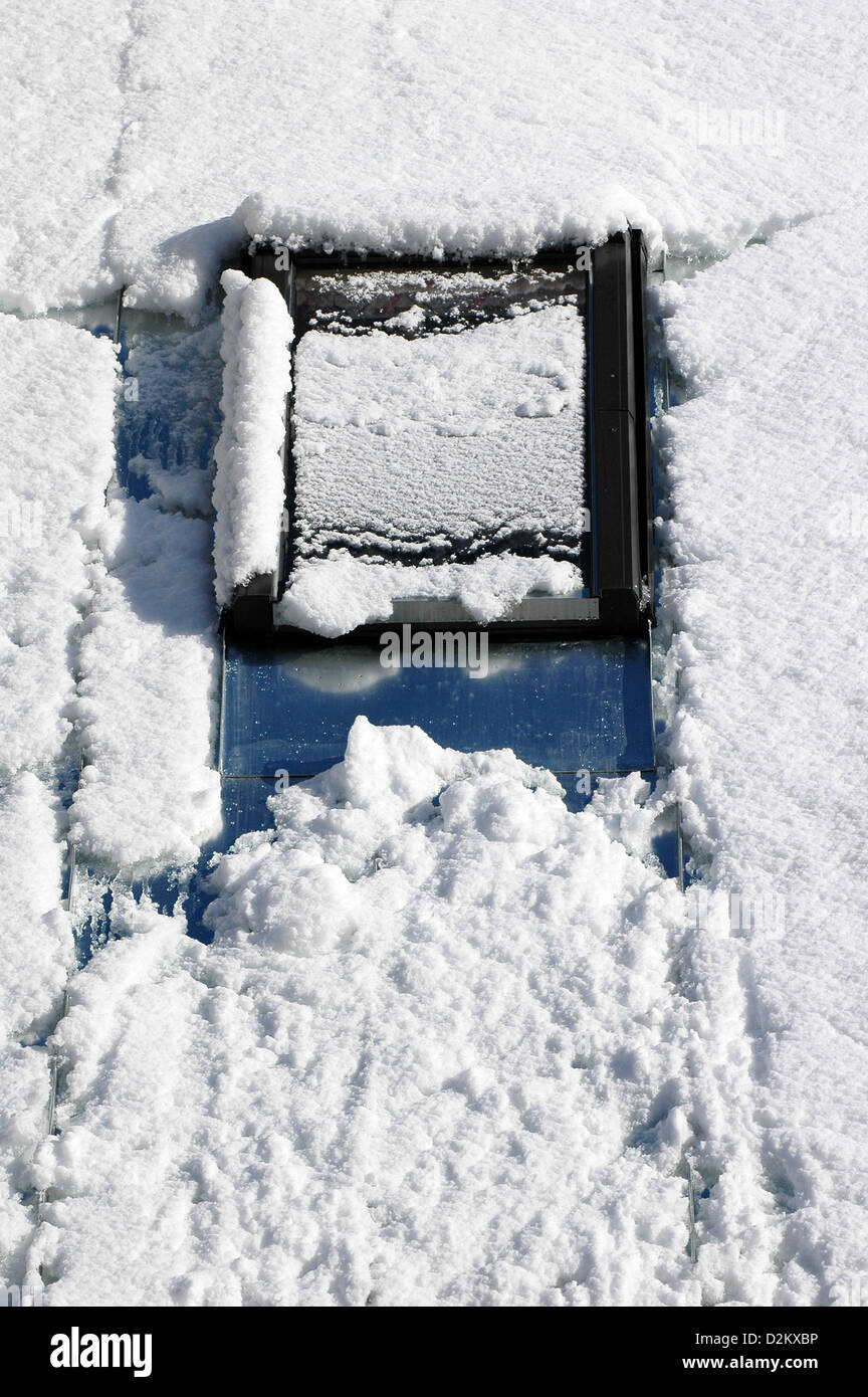 roof window covered of snow on the roof at winter - Stock Image