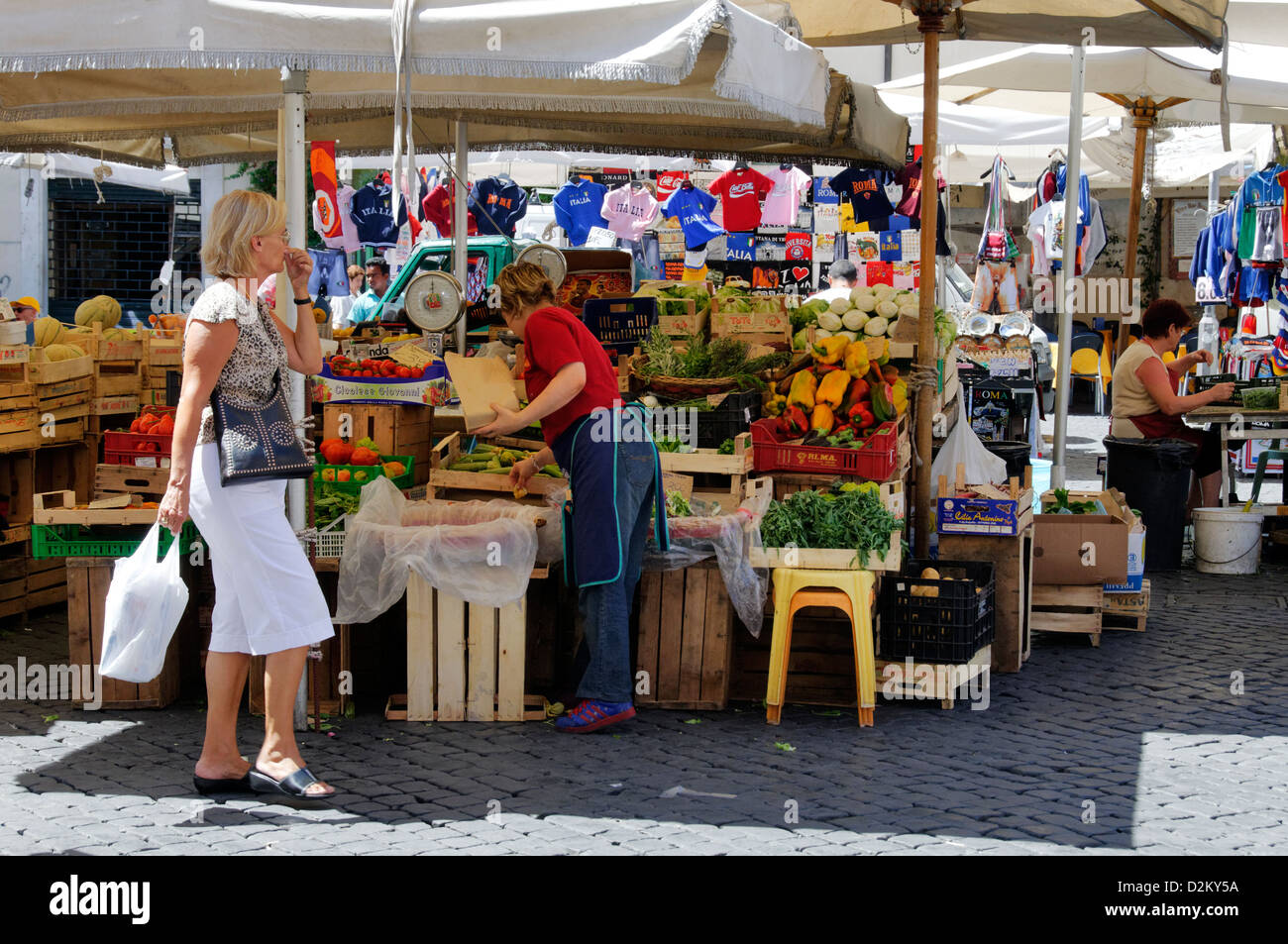 Rome. Italy. View of market stalls selling fruit and vegetables at the piazza known as Campo dei Fiori - Stock Image