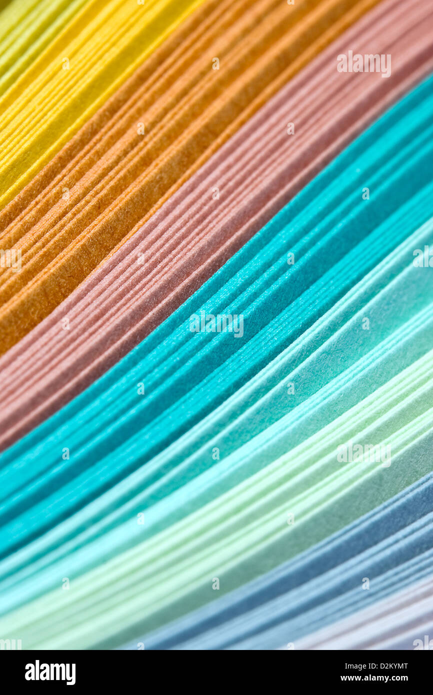 Abstract design of paper filigree strips in pastel colors - Stock Image