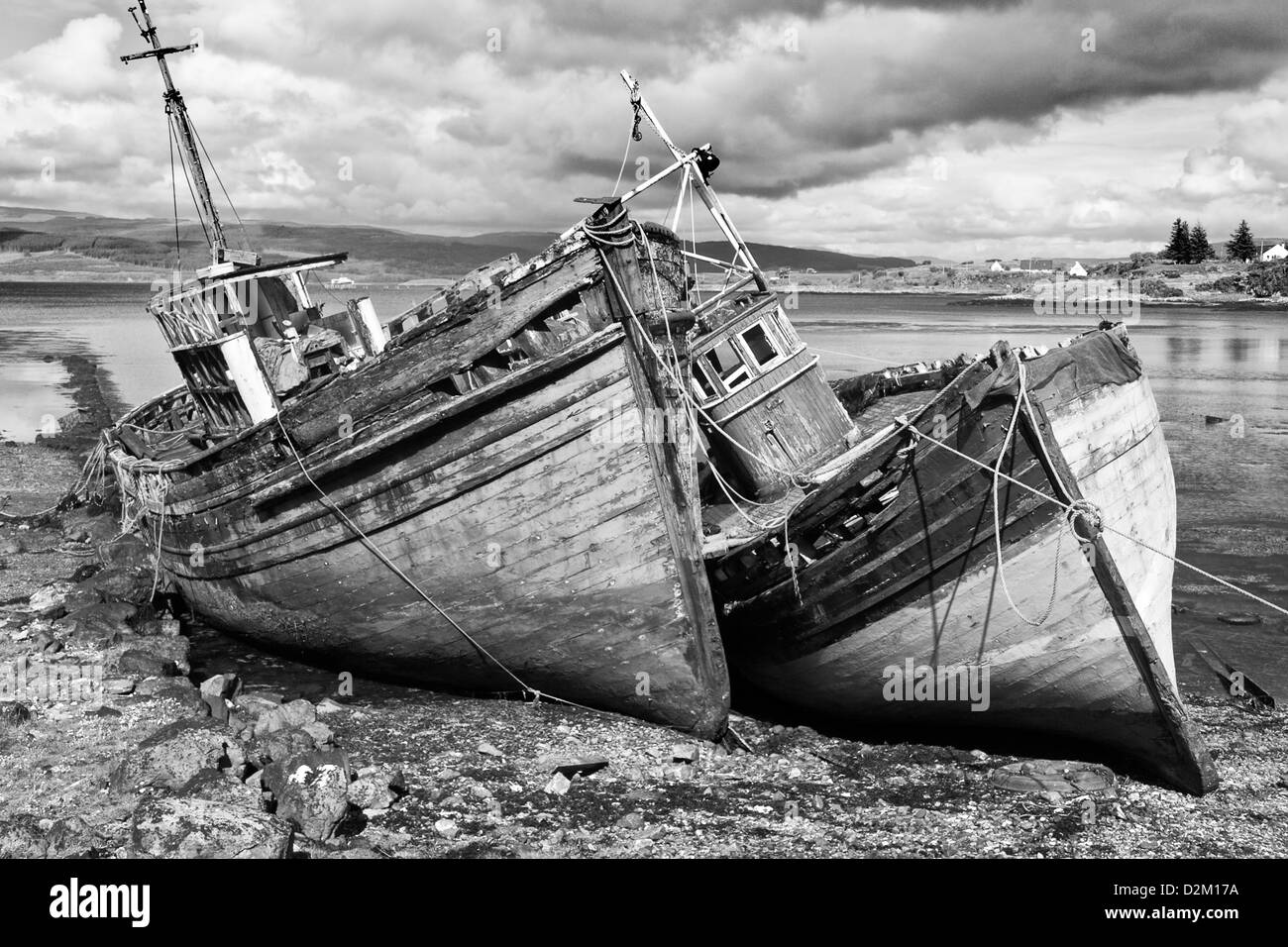 Beached fishing boats wrecks near Salen on the Isle of Mull, Inner Hebrides, Scotland - Stock Image