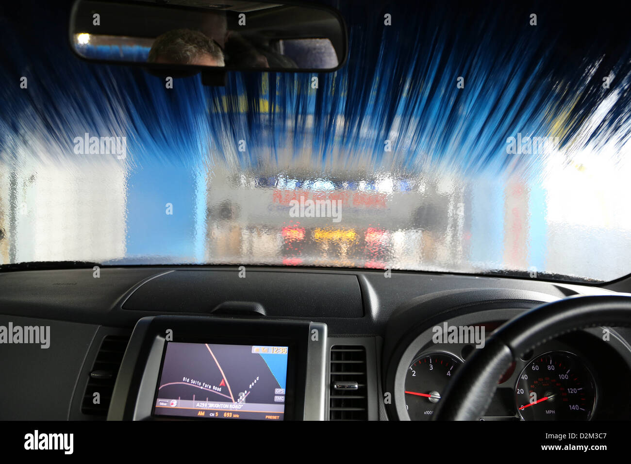 Nissan X Trail going through a car wash in Shoreham West Sussex - Stock Image