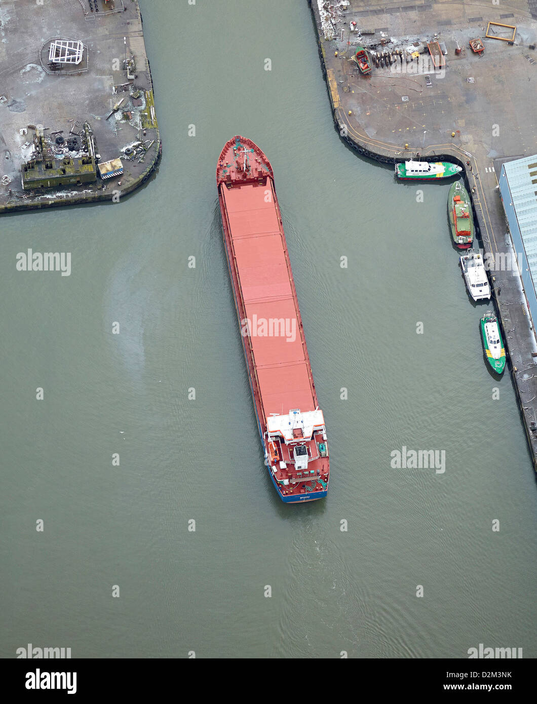 Freight Ship manouvering in Liverpool Dock, North West England - Stock Image