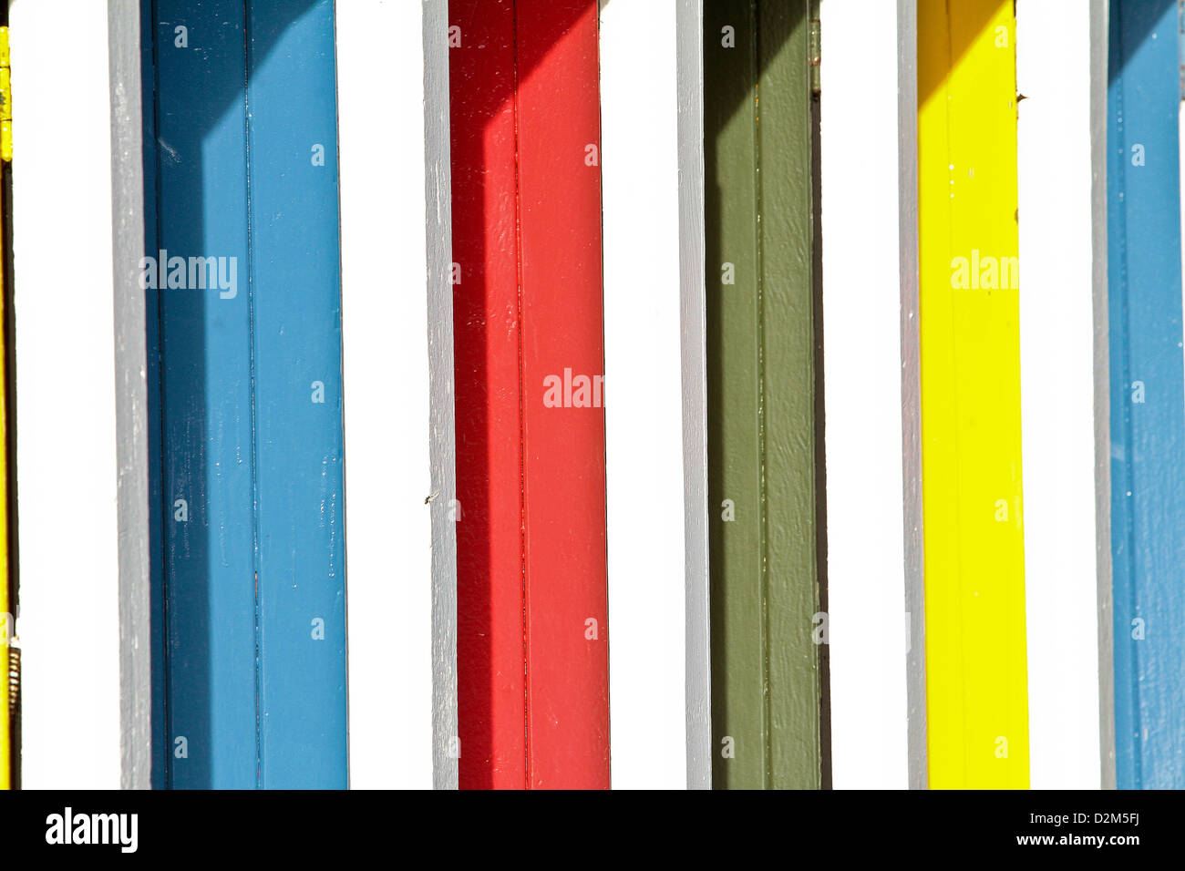 coloured doors to outdoor changing rooms at the open air swimming pool at Tooting Bec Lido south London UK - Stock Image