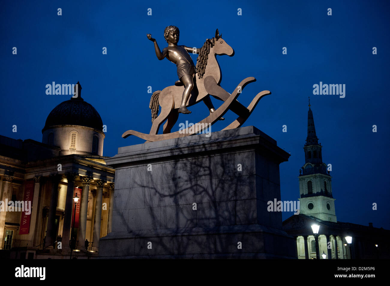 Trafalgar Square at Dusk showing Powerless Structures, Fig. 101 by Elmgreen and Dragset also known as Boy on a Rocking - Stock Image