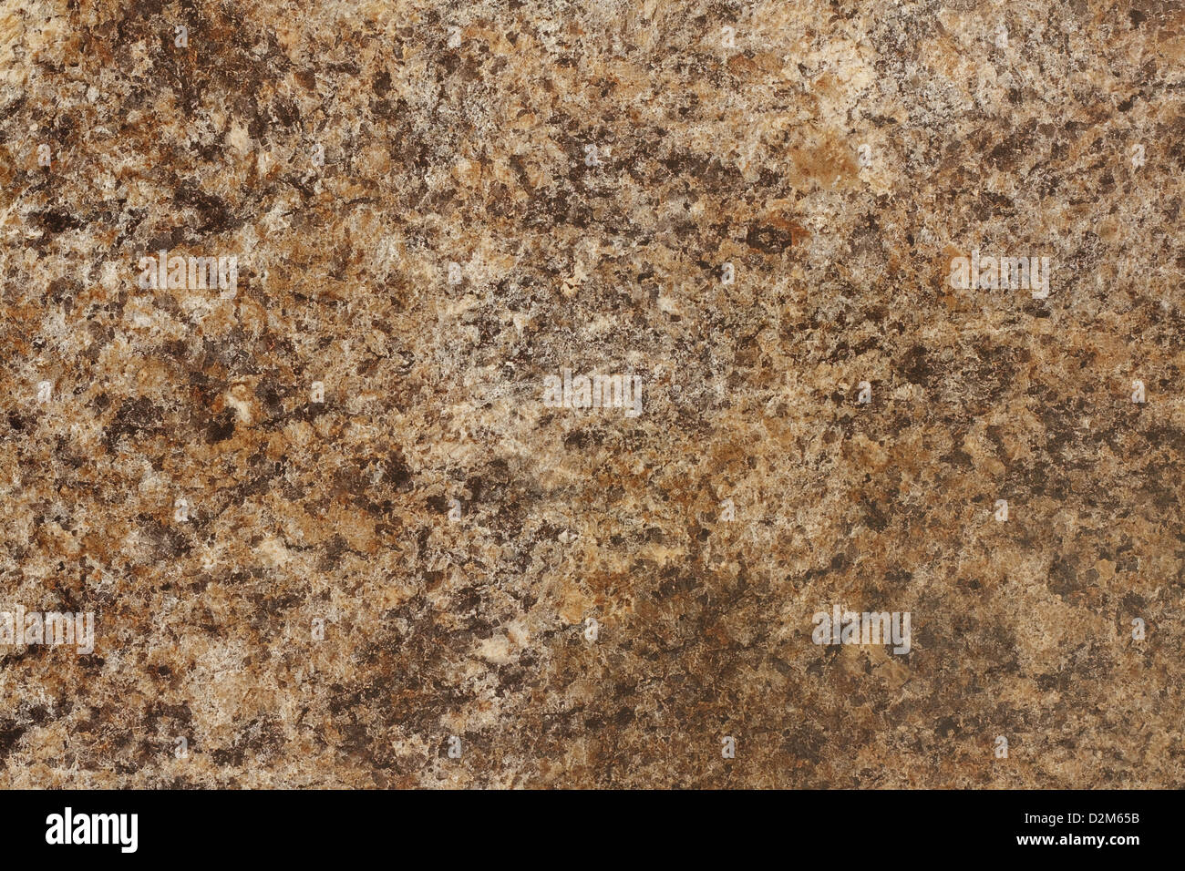 Stone Background of mottled granite igneous rock used for kitchen worktops etc - Stock Image
