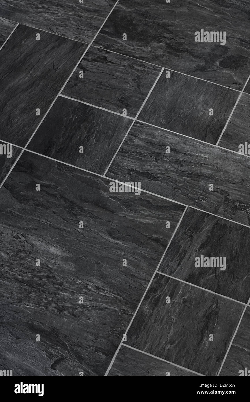Solid stone Slate flooring a popular choice for modern kitchens and bathrooms - Stock Image