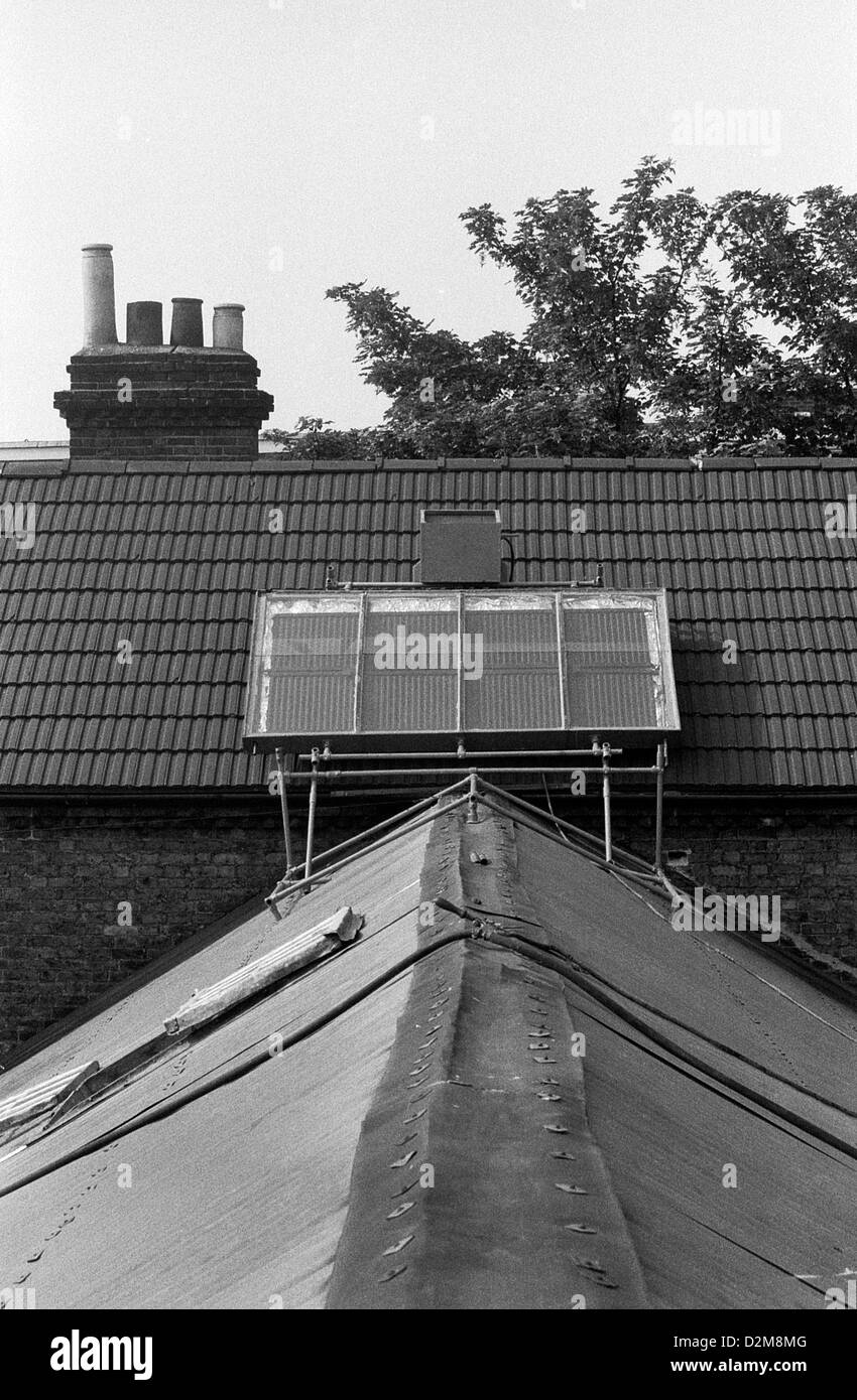 A homemade solar panel on the roof of a squatted house squat property in 1974 Camberwell South London  England UK - Stock Image