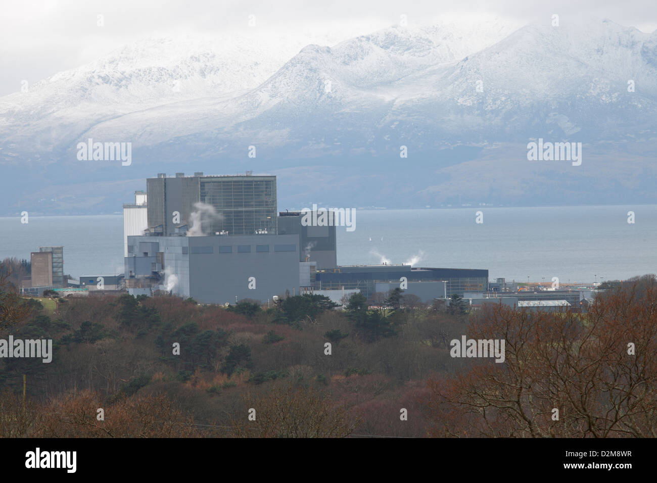 Hunterston B Nuclear Power Station near Largs in Ayrshire with snow caped Isle of Arran in the background. - Stock Image