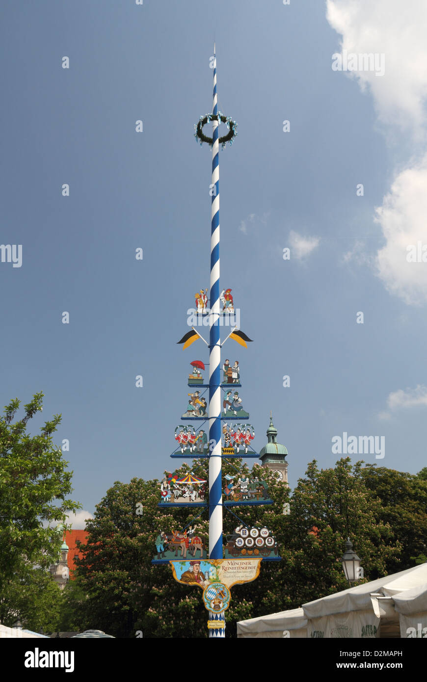 Munich market square 'maypole' - city sign showing local crafts and industries. - Stock Image