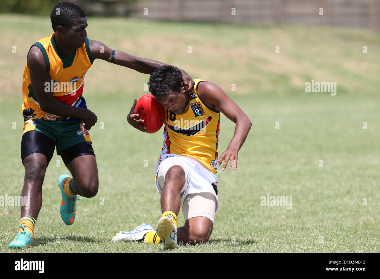 POTCHEFSTROOM, SOUTH AFRICA - JANUARY 28, Thabiso Phakedi (GP Blues) of the SA Lions tackles Kyle Jackson (Whyalla, - Stock Image