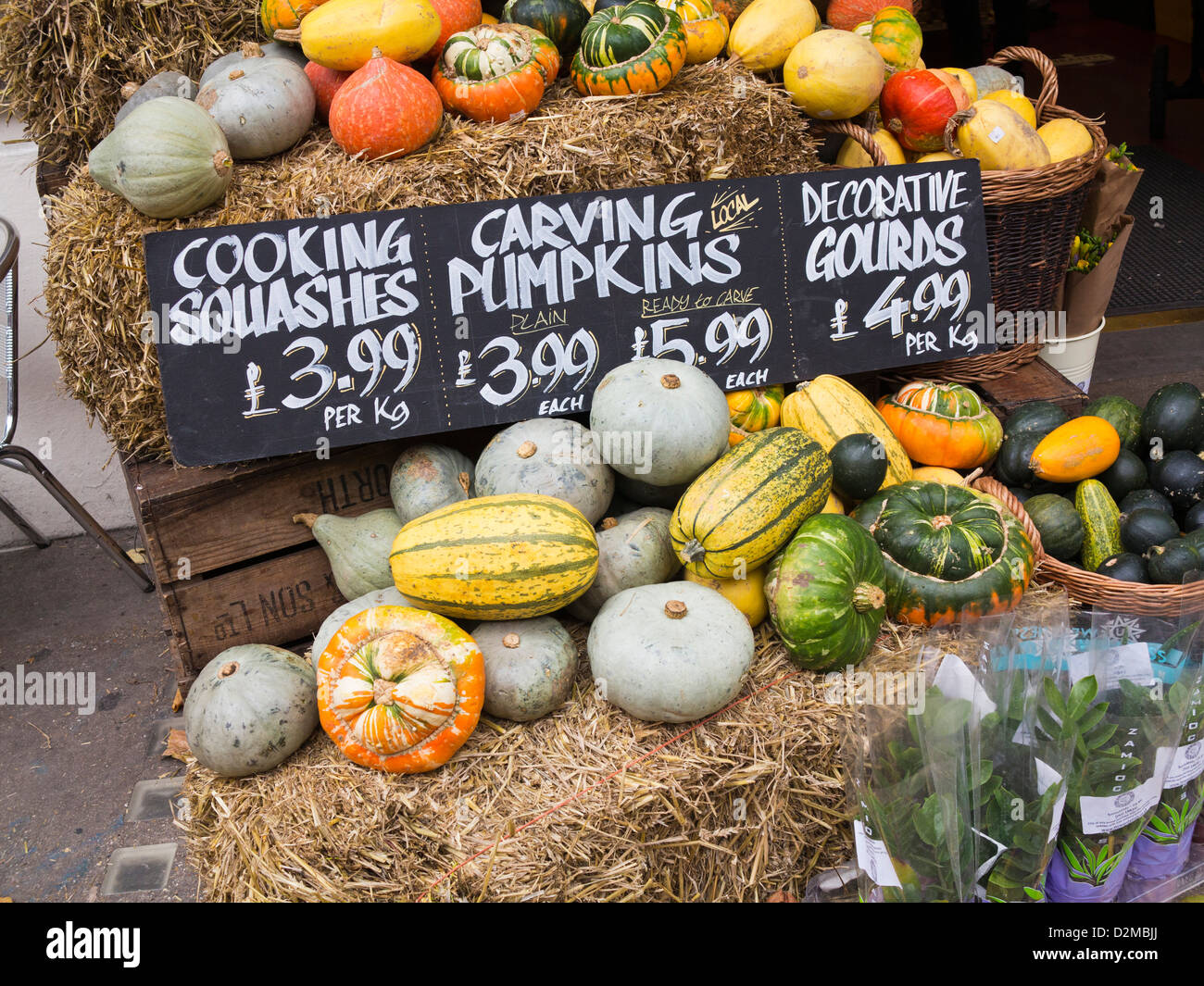 Pumpkins on a stall, UK - Stock Image