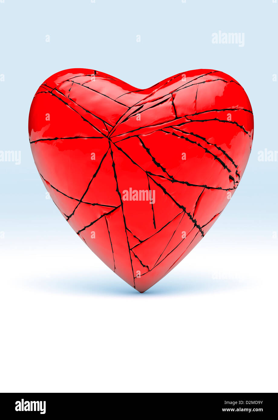 Heart broken - red love heart relationships / relationship break up concept - Stock Image