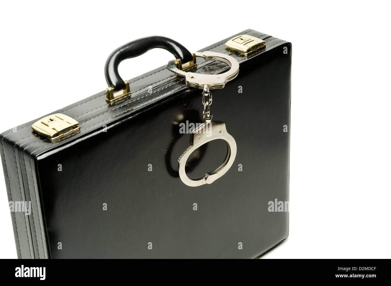 Briefcase and handcuffs - Stock Image