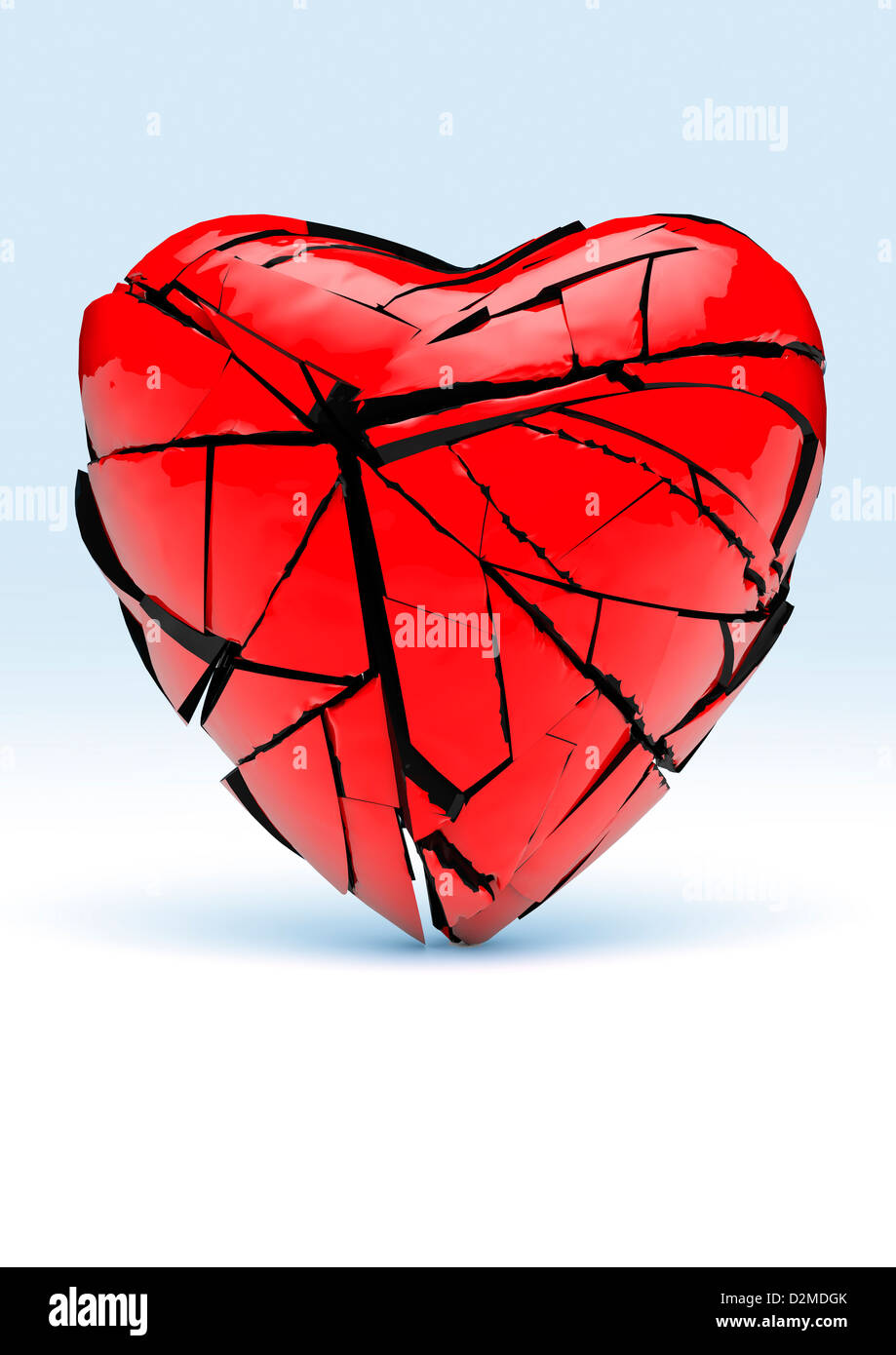 Broken heart - red love heart cracking and breaking into pieces - Stock Image