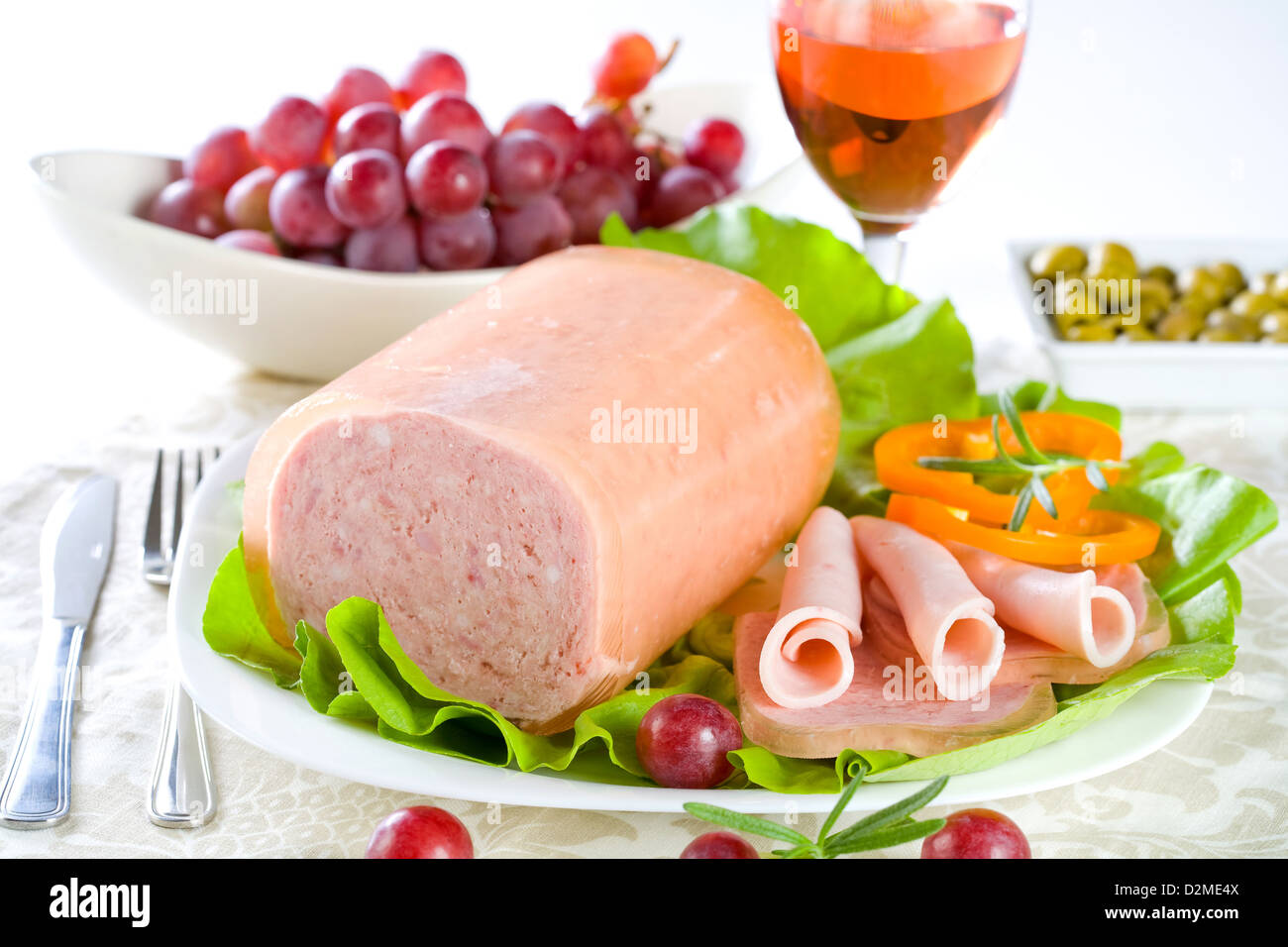 Luncheon meat, salad, olives and grapes - Stock Image