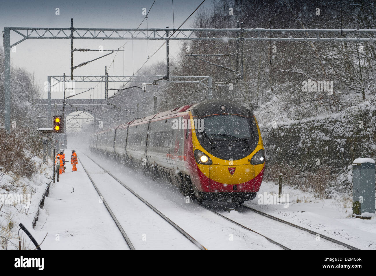 In snow a Virgin Trains Class 390 Pendolino heads towards