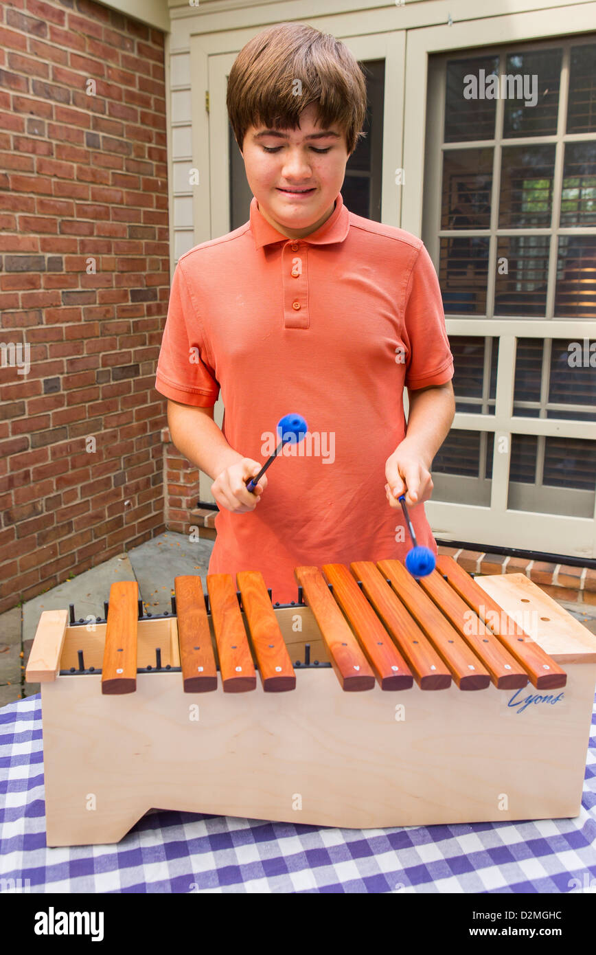 VIRGINIA, USA - Autistic boy, 14 years old, plays marimba, also known as glockenspiel. MR - Stock Image