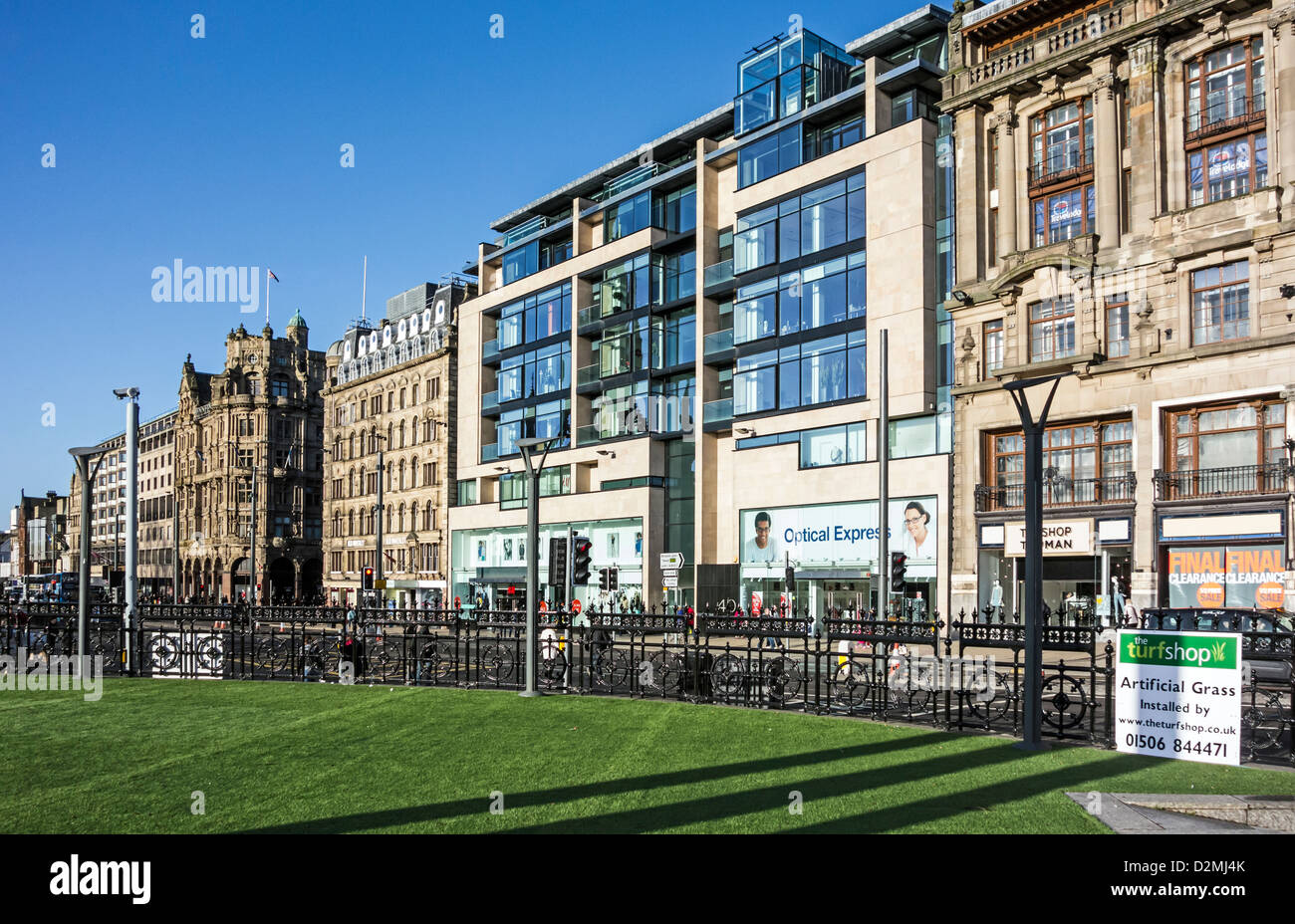 New artificial grass laid on top of Princes Mall in Edinburgh with Princes Street buildings and shops behind. - Stock Image