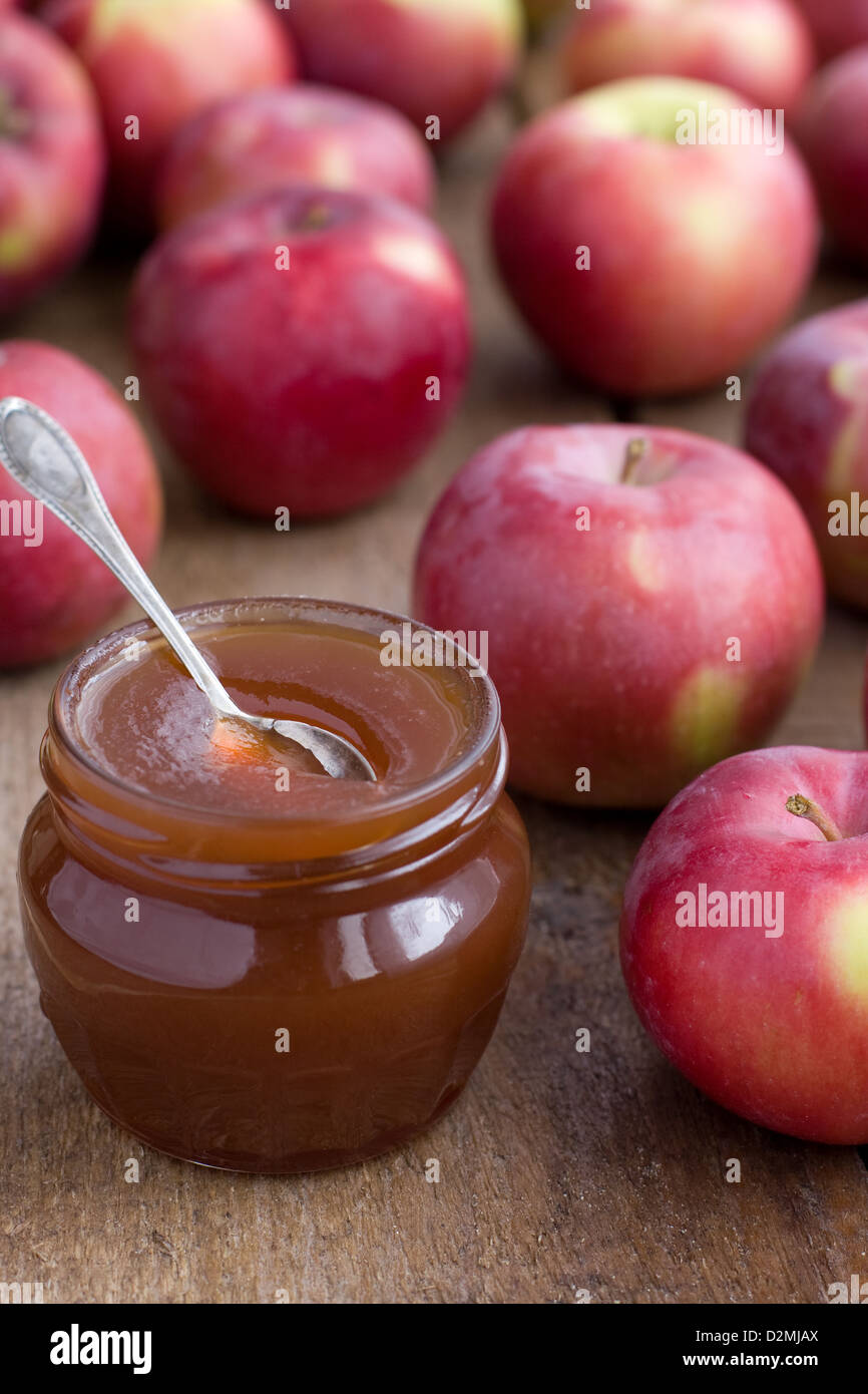 Apple confiture in Glass Jar with red apples - Stock Image