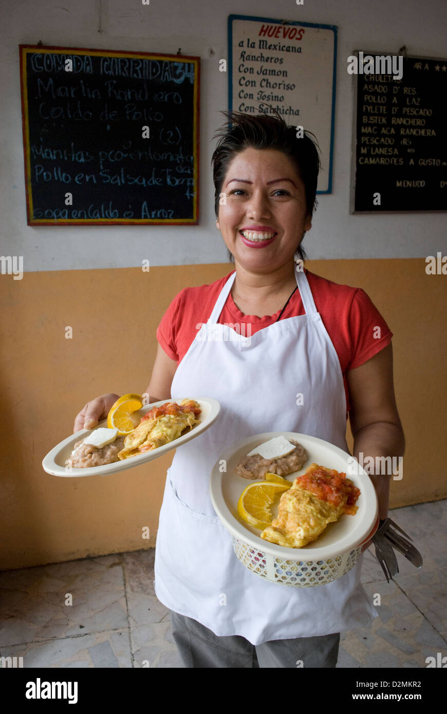 Mexico Mazatlan Sinaloa State Waitress restaurant serving Huevos Rancheros. - Stock Image