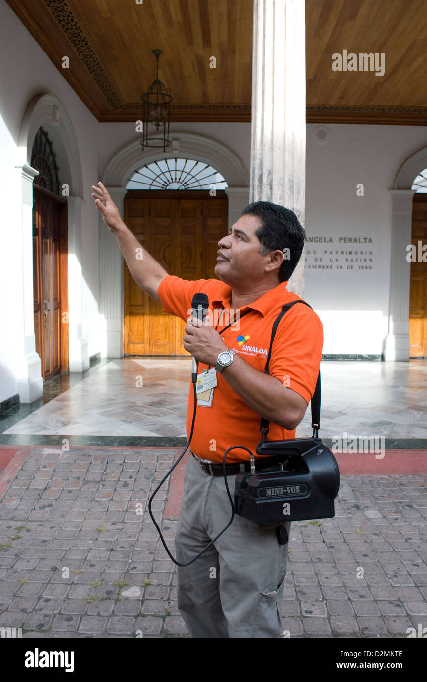 Tour guide explaining history of Old Mazatlan,Mexico to visiting