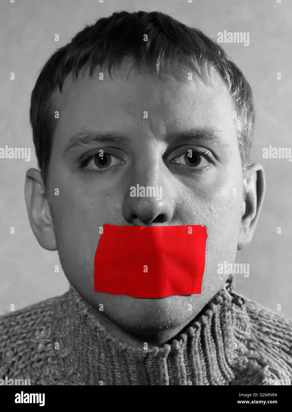 man with closed red tape mouth, creative, symbolizing the fight for freedom of speech and against censorship - Stock Image