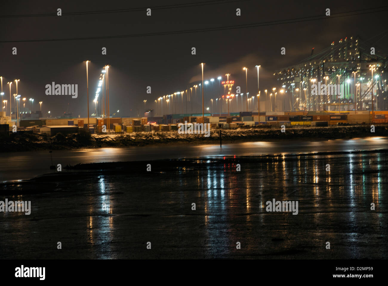 Night photograph of the Southampton Container Port, Southampton Water, Southampton, Hampshire, England, UK. - Stock Image