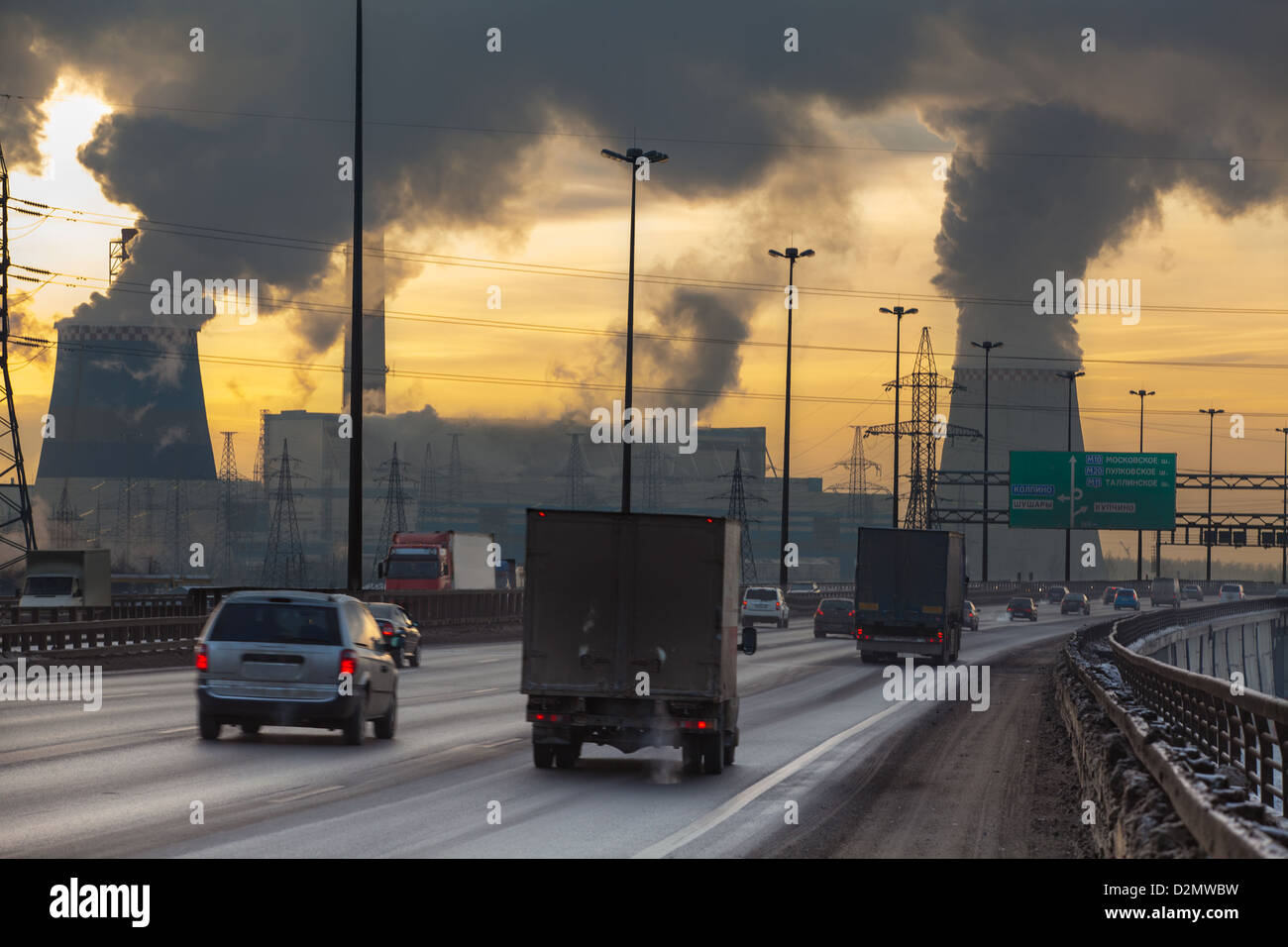 City ring way with cars and air pollution from heat electric generation plant in Saint-Petersburg, Russia - Stock Image