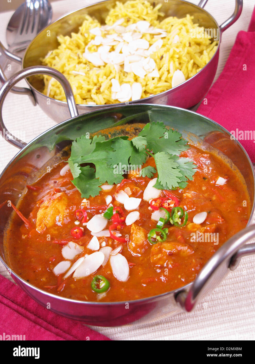 Chicken vindaloo stock photos chicken vindaloo stock images alamy a bowl of goan chicken vindaloo topped with sliced almonds sliced chillies and fresh coriander forumfinder Images