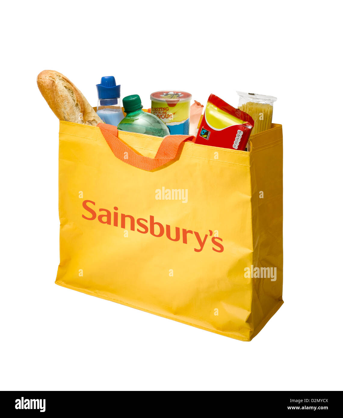 A mustard yellow Sainsbury's shopping bag on a white background - Stock Image