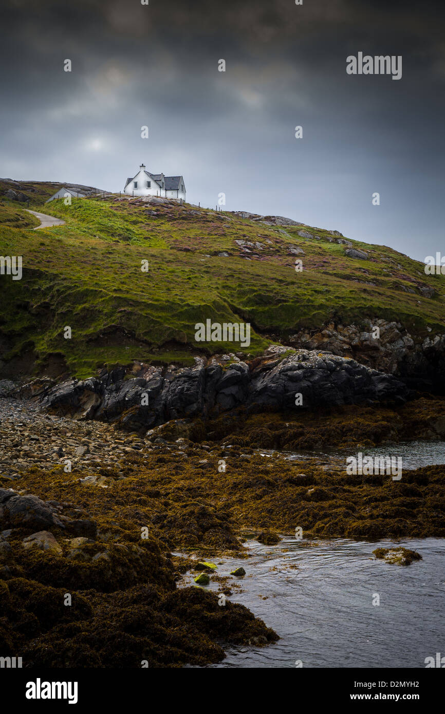 Isolated House on a cliff overlooking the sea shore Stock Photo