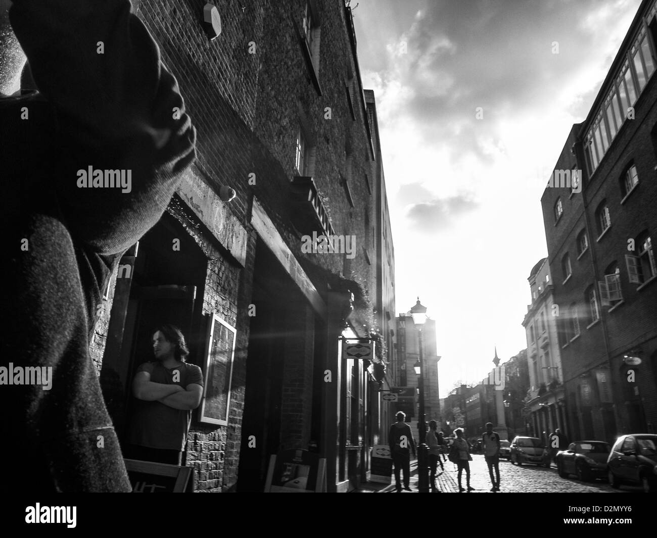 a man o a street in spring evening light - Stock Image