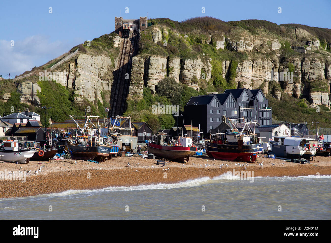 Fishing fleet drawn up on beach and East Hill lift, Hastings, Sussex, England, United Kingdom, Europe - Stock Image