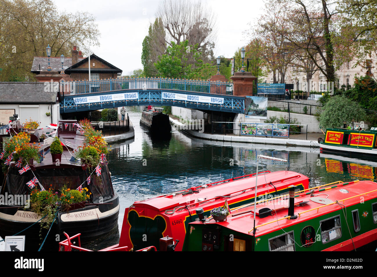 The Grand Union Canal showing the Westbourne Terrace Road Bridge, Little Venice, Maida Vale, London, England, UK - Stock Image