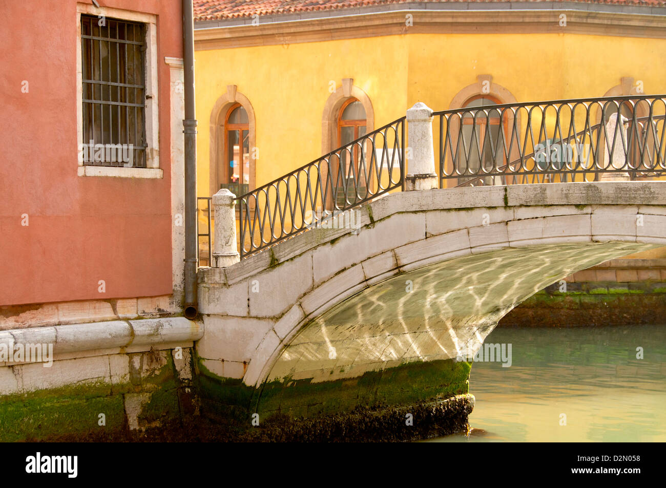 Bridge over canal with water reflections, Venice, UNESCO World Heritage Site, Veneto, Italy, Europe - Stock Image