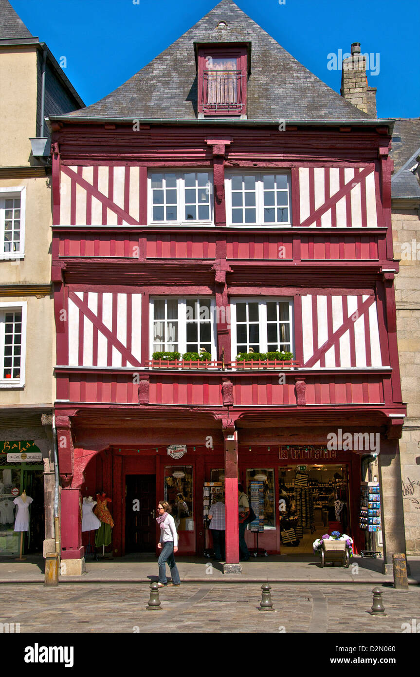 Shops and red half timbered house, Cordeliers Square, Dinan, Brittany, France, Europe - Stock Image
