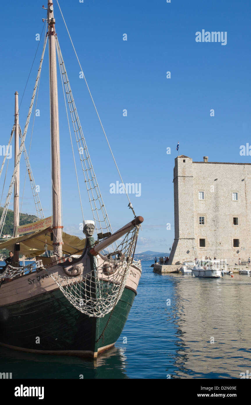 A local tourist boat moored in the old harbour, Old City, Dubrovnik, UNESCO World Heritage Site, Croatia, Europe - Stock Image