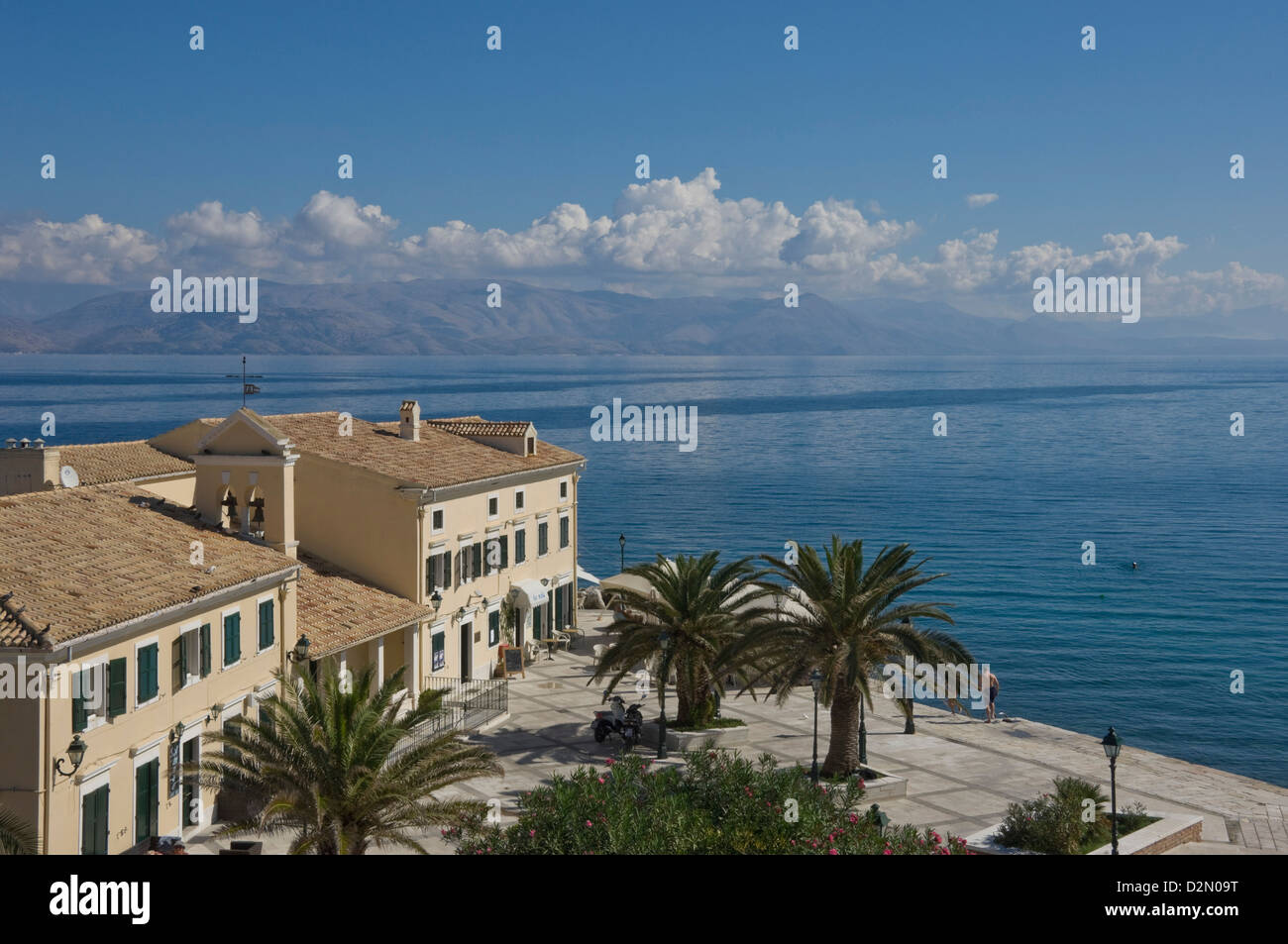 Sea view over a sea side cafe from Corfu Town, Corfu Island, Ionian Islands, Greek Islands, Greece, Europe Stock Photo