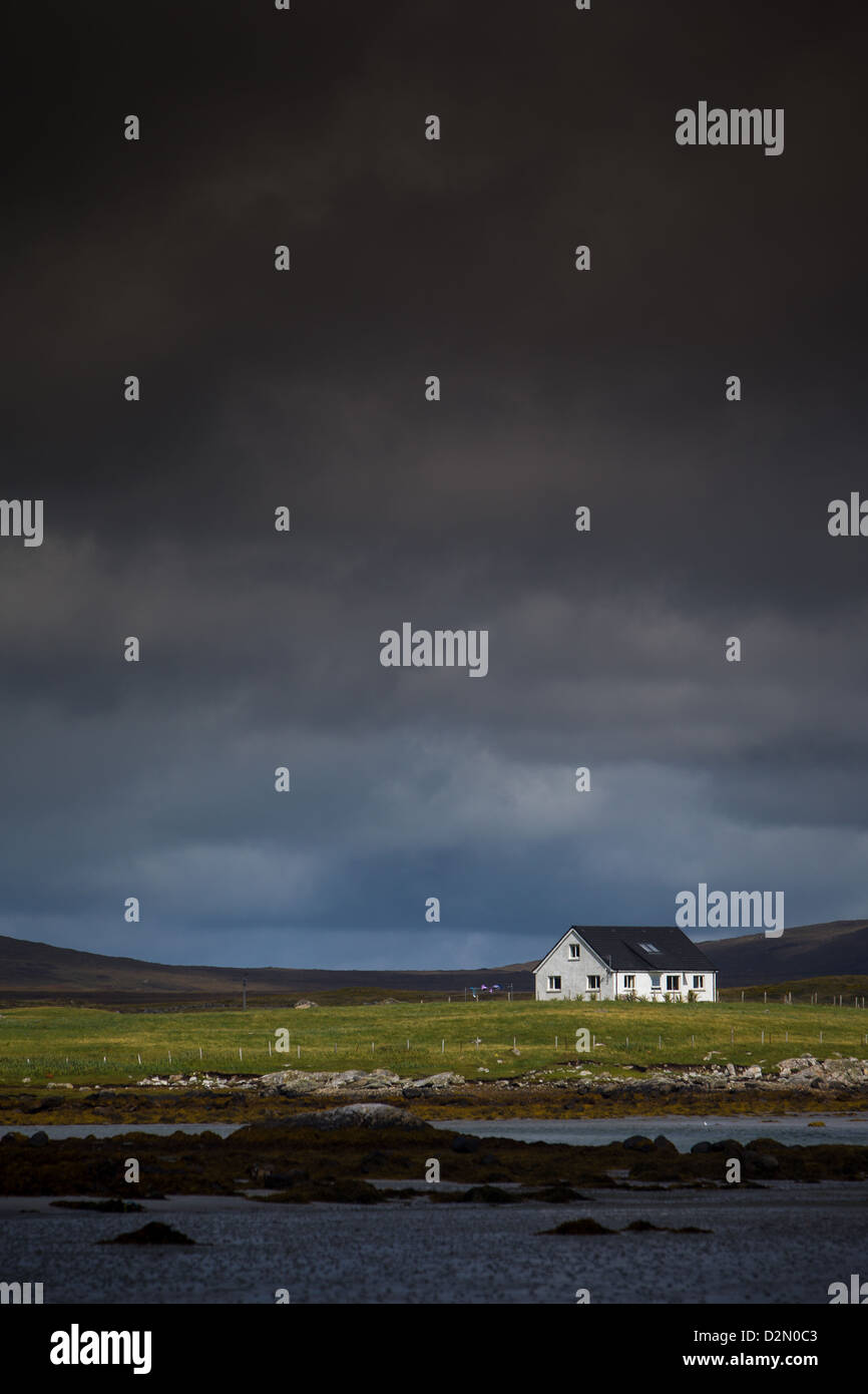 Isolated House next to the sea at North Uist in the Outer Hebrides - Stock Image