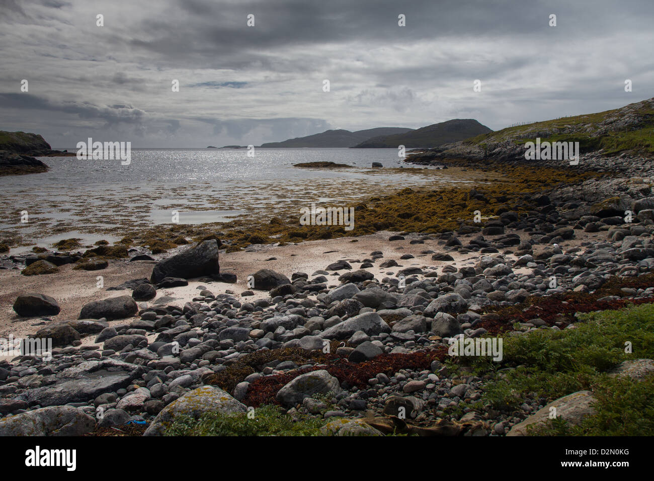 A beautiful sandy and rocky beach on the Isle of Barra in The Outer Hebrides Stock Photo