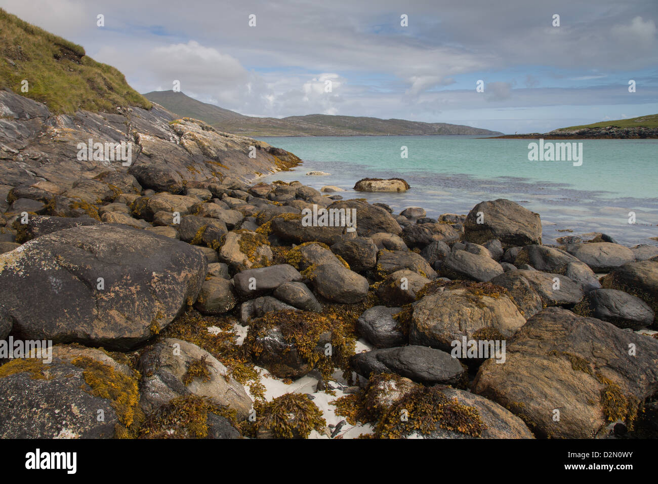 A beautiful sandy and rocky beach on the Isle of Barra in The Outer Hebrides - Stock Image