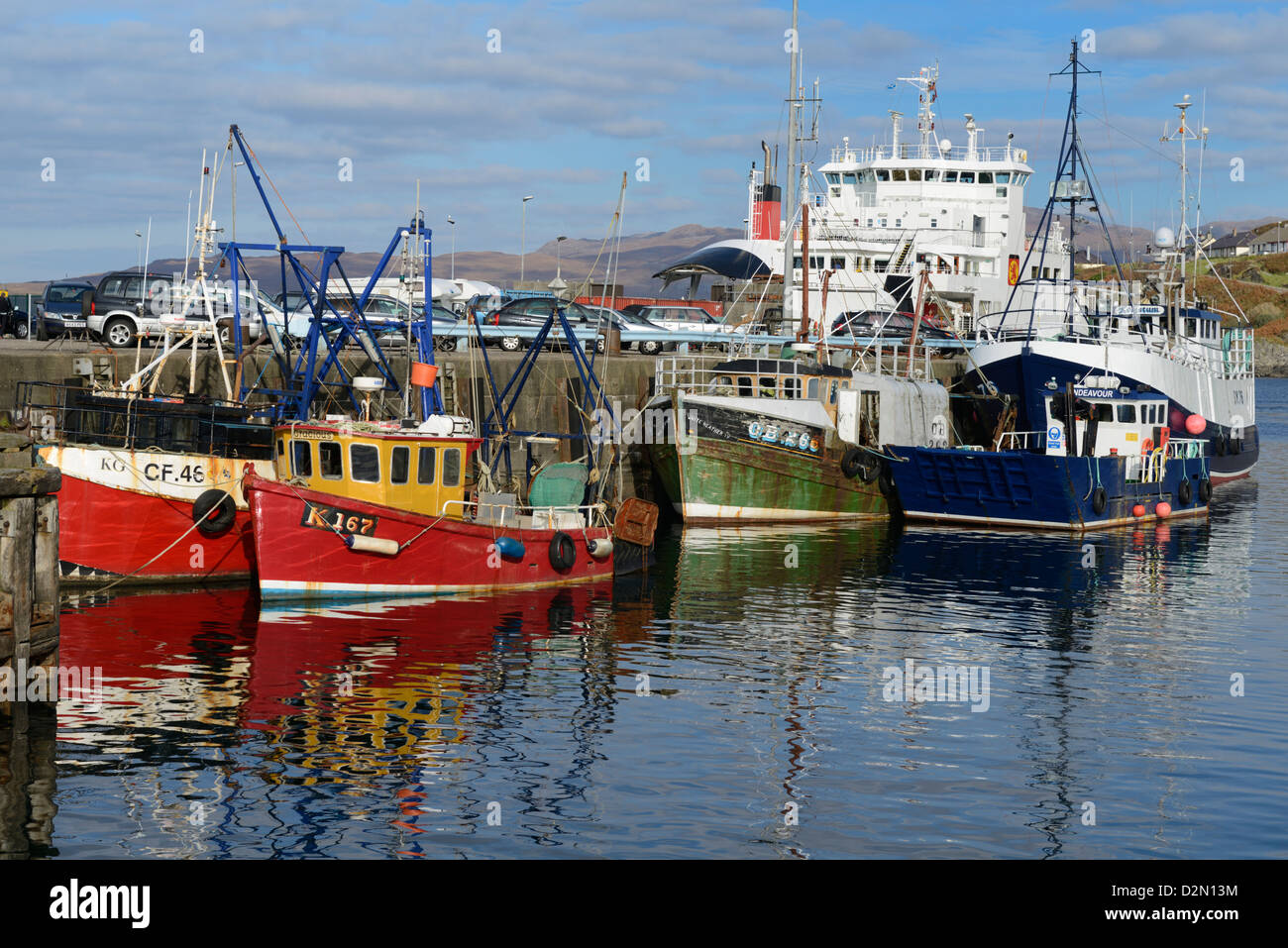 Fishing boats and Car Ferry in the harbour, Mallaig, Highlands, Scotland, United Kingdom, Europe - Stock Image