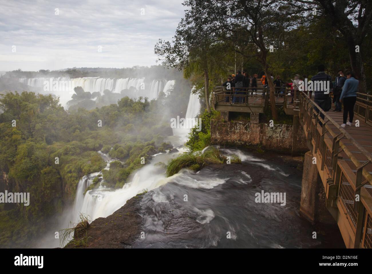 Tourists at Iguazu Falls, Iguazu National Park, UNESCO World Heritage Site, Misiones, Argentina, South America Stock Photo