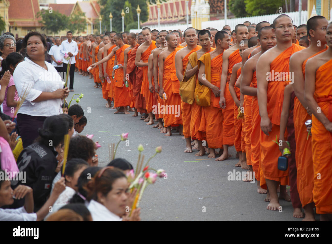 Monks in mourning parade for the late King Sihanouk outside Royal Palace, Phnom Penh, Cambodia, Indochina, Southeast Stock Photo