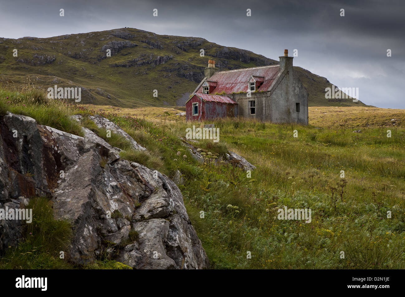 An Old Abandoned cottage on a hillside in Eriskay in the Outer Hebrides - Stock Image