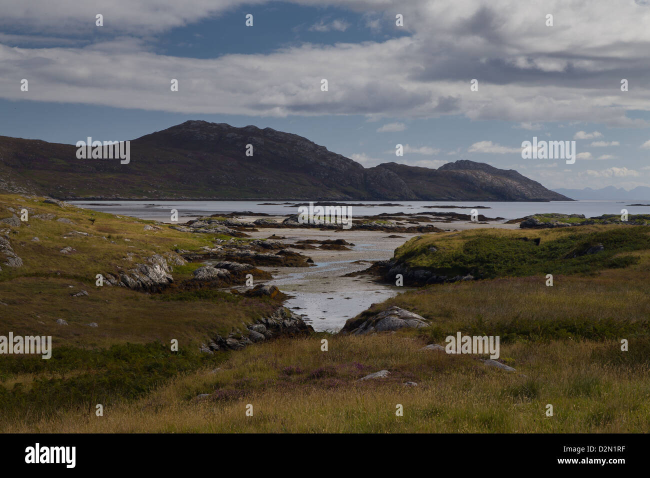 view from South Uist looking acrros the shoreline in the Outer Hebrides - Stock Image